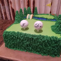 Golf Lover Groom's Cake Chocolate cake, buttercream icing, fondant bridge, ice cream cone/buttercream trees, real golf balls with vinyl cutout lettering.