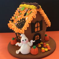 Halloween Mini Halloween gingerbread house, fondant ghost, royal icing, assorted candies