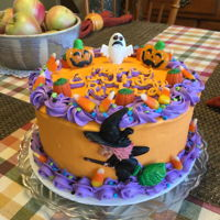 Halloween Birthday Cake Carrot cake with cream cheese frosting. Purple frosting is canned icing. Decorated with candy and plastic witch. Made for my sweet husband...