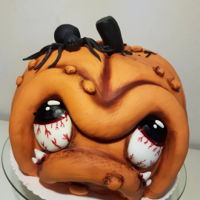 Halloween Pumpkin Cake Pumpkin cake for a halloween party. Cake is filled with chocolatecake and chocolate ganache.