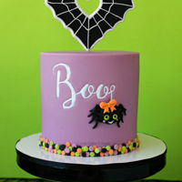 Halloween Spider Cake This cake features a fondant heart spiderweb, embossed font, a sweet spider and edible confetti. Find the full tutorial and step by step...