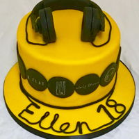 Headphones And Band Logo Cake Chocolate cake with fondant headphones, lettering made from extruded fondant and hand drawn band logos