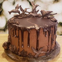 Hummingbird Birthday Cake Devil's food cake torted and filled with chocolate mousse and whipped dark chocolate ganache; iced with whipped cream chocolate...