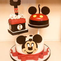 Mickey Mouse Cake Mickey Mouse cake with toppers made of cake and RK treats.