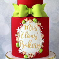 Mrs Claus' Bakery Cake Tutorial In this How To Make A Mrs Claus' Bakery Cake Tutorial you'll see how easy it is to emboss gold writing on a cake, make...