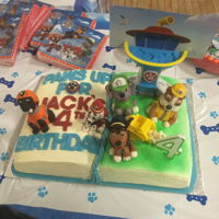 "Paw Patrol Birthday ""Pop-up"" book featuring 5 Paw Patrol pups made of fondant."