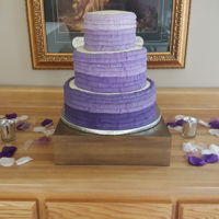 Purple Ombre Wedding Cake This was my first wedding cake. To spite the fact I was nervous as heck about it and I'm glad to have over with. I enjoyed doing it!