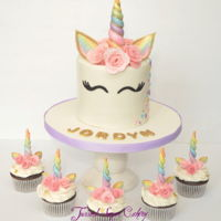 Rainbow Unicorn A little bit of a different twist on the ever so popular unicorn cake.