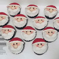 Santa Claus Face Cupcakes Fondant cupcake toppers. His cap was decorated with red glitter flakes. Cupcakes are Mississippi Mudd with a pots de creme filling and...