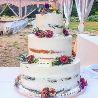 Semi Naked Wedding Cake A semi naked cake for a rustic lodge wedding in Massachusetts. The bottom and top tiers are chocolate buttermilk with chocolate ganache,...