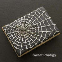 Spider Web Royal icing on a decorated sugar cookie. The spider is royal icing as well.