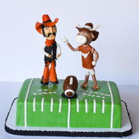 Texas/osu Football Cake A traditional cake for this rival game. Pistol Pete and Bevo made out of gum paste.