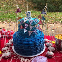 """the Big One"" 10/6 inch tiers all buttercream with matching smash cake and ""bobber"" cake pops!Bunting provided by mother."