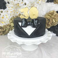 Tuxedo Cake Adorable little tuxedo cake with custom toppers - I made these out of fondant a few days before and painted them gold! Too bad I couldn&#...