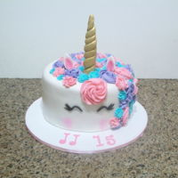 Unicorn Cake vanilla cake covered with fondant, horn is gum paste and swirls are buttercream