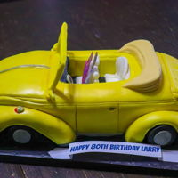 Vintage Volkswagen Beetle Convertible All cake and nearly all edible. There is a small wire in the frame of the windshield and the photo of the people are not edible. This cake...