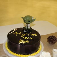 Yoda Grooms Cake Black mirror glaze cake with Yoda