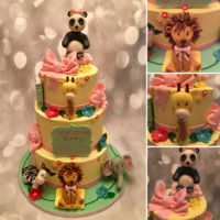 Zoo Animals And Book Themed Baby Shower Cake. Handmade fondant animals and decorations. Buttercream frosted cake for a baby girl.