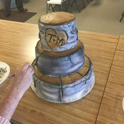 Aspen Cake 2018 This is an Aspen Log wedding cake done in fondant with airbrushed decorations.
