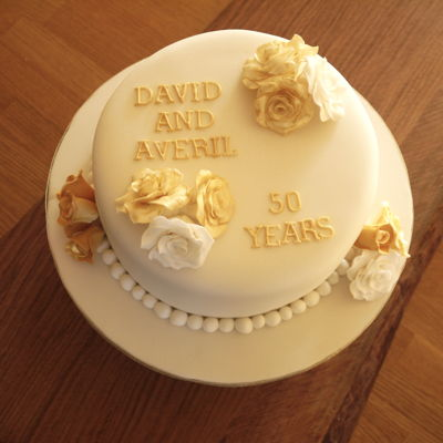 Golden Wedding Anniversary Sponge cake filled with vanilla buttercream and covered with fondant.