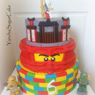 Lego Ninjago Cake Lego Ninjago cake made with fondant. All the figures are hand crufted made with modelling paste. Please note all the cake toppers are...