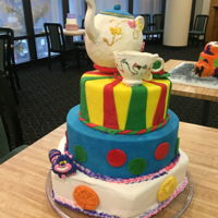 A Very Happy Unbirthday Cake This cake was my final project in Advanced Baking. It is 3 tiered, fondant covered with fondant figures and decoration