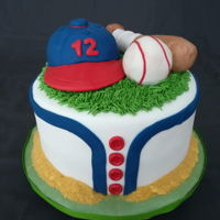 Baseball Cake Baseball cake I've made for my niece's 12th birthday. Cap, bat and ball are made with rice krispie treat covered in fondant. Sand...