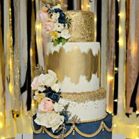 Blue And Gold Wedding Cake Blue and Ivory fondant adorned with gold brush stroked and sequins for a dramatic look