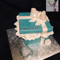 Chrystal & Co. Done by yours truly!!! Instead of Tiffany let's make it Chrystal!! Custom gift box cake. Covered in my favorite Satin ice fondant...