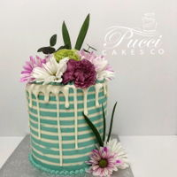 Colourful And Stripes White and teal stripes made from smbc with chocolate melt stripes and fresh flowers