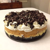 Double Layer Pumpkin Oreo Cheesecake Made this for Thanksgiving. First time making a traditional baked cheesecake with a springform pan and water bath. It has an Oreo crust, a...