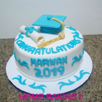 Graduation Cake chocolate cake covered in fondant