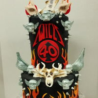 "Heavy Metal Cake 40Th Birthday Double-barrel 6"" atop 8"". One of the most fun cakes of 2018- Client was very happy; a surprise for the husband's 40th..."