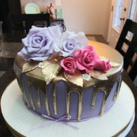 Lilac Gold Drip The cake cover with fondant ,royal icing drip and gumpaste flower.