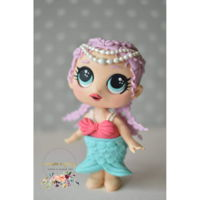 Merbaby Inspiration from the L.O.L. doll Merbaby. This is made with fondant and modeling chocolate.