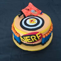 Nerf Cake I've made this cake for my nephew 12th birthday. Nerf darts are made with pirouline cookies covered in fondant and the gun is a toy.