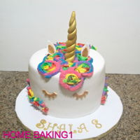 Rainbow Unicorn Cake chocolate cake covered in fondant