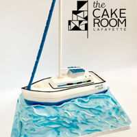 Sail Boat This cake features a fondant sail boat sailing the sugary ocean!
