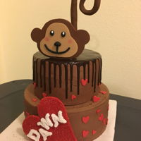 Sweet Monkey Chocolate layers with brownie batter buttercream, ghiradelli chocolate drip and fondant accents. Letters on heart were painted with piping...