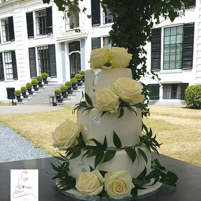 Weddingcake With Roses And Silverleaf