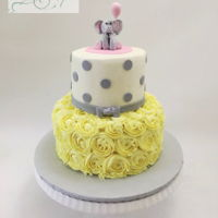 Baby Shower Cake - Yellow And Grey Buttercream iced two tier baby shower cake. Elephant is made from modeling chocolate. Thanks for looking!
