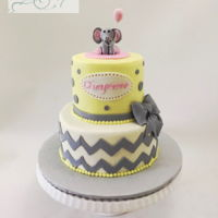 Baby Shower Grey & Yellow Cakes Buttercream iced tiers with fondant chevron design and fondant bow. The elephant is modeling chocolate.