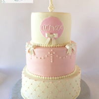 Baptismal Cake 3 tier, buttercream iced cake with edible pearls. Bows are fondant. Cross is chocolate. Thanks for looking!