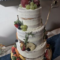 Bohemian Rhapsody 3 tier semi-naked cake with dried fruit, sugared fruit and fresh rosemary.