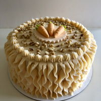 Carrot Cake Carrot cake with buttercream ruffles and fondant carrots