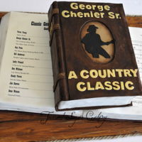 Classic Country Songs Edible images of a list of favorite songs and sheet music. Made for a 70th birthday for a guitar player.