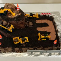 Digger Cake Digger cake with spiral ramp and construction trucks and accessories.