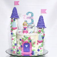 "Dino Princess Castle 6"" vanilla cakes stacked and filled with buttercream, embellished with fondant decorations. Castle turrets are styrofoam..."