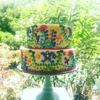 "Fiesta Floral Cake 8"" and 6"" cakes stacked, filled and iced with American buttercream. Buttercream piping."