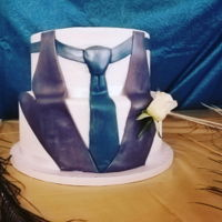 Groom's Cake Smooth buttercream with fondant embellishments. Airbrushed pearl for shine. Silk flower boutiner.